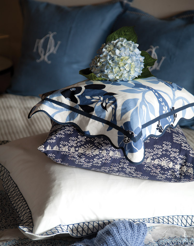 A deep layering of pillows provides gentle comfort in a sumptuous nest of color, pattern, and texture.