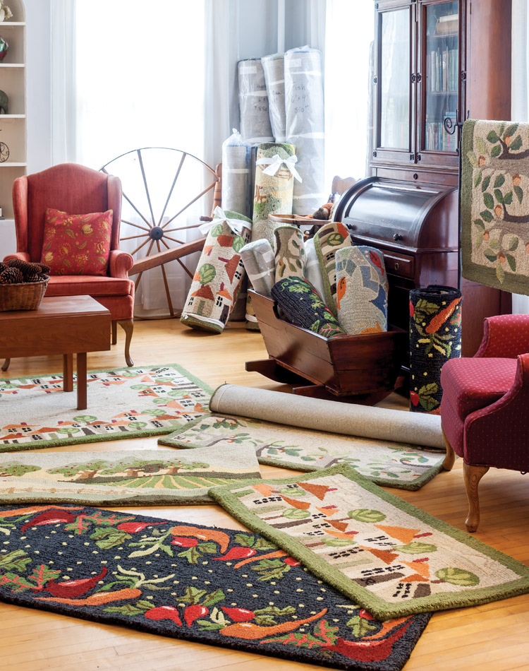 Original hand-hooked wool rugs fill Judith Reilly's Vermont gallery.