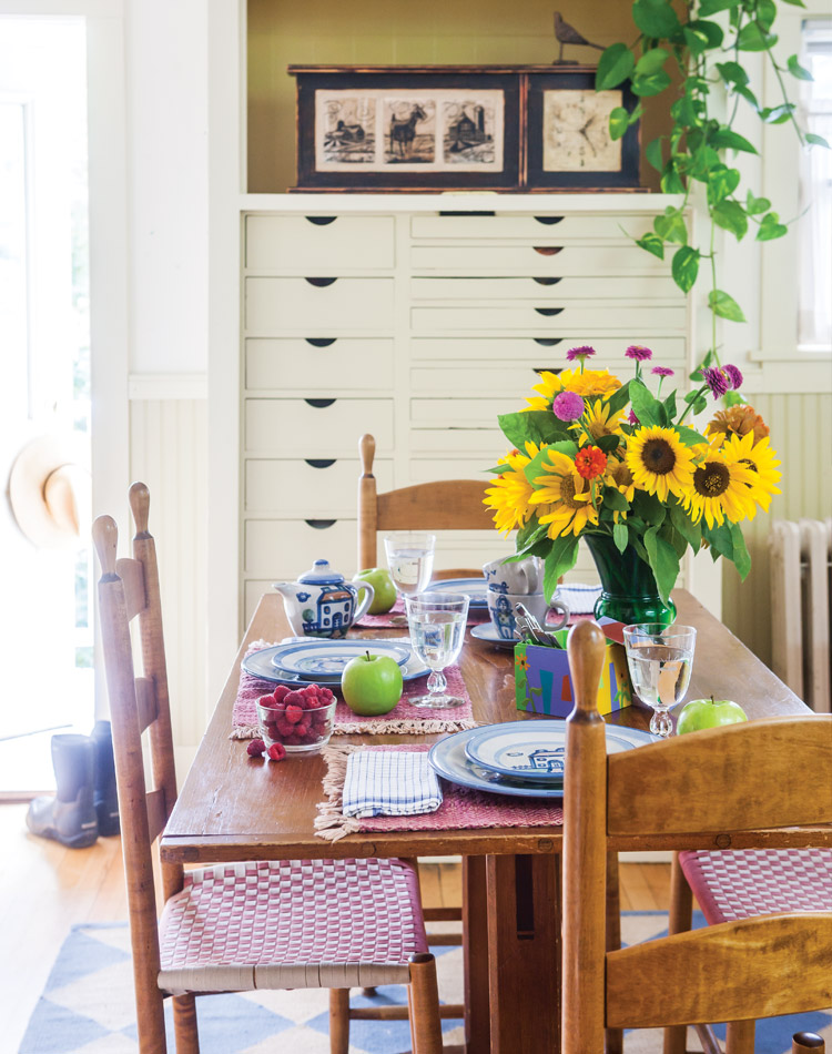 Fresh-picked raspberries and floral stems bring summertime delight to the kitchen table that Judith Reilly's husband, George, constructed many years ago.