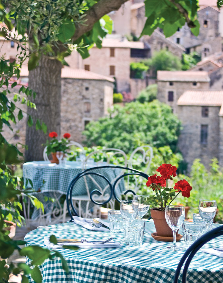 Romantic interiors evoke the charm of bygone days for visitors to Les Fleurs d'Olargues. International restaurateurs found their place in the French countryside—an oasis they share with those who come calling from near and far.