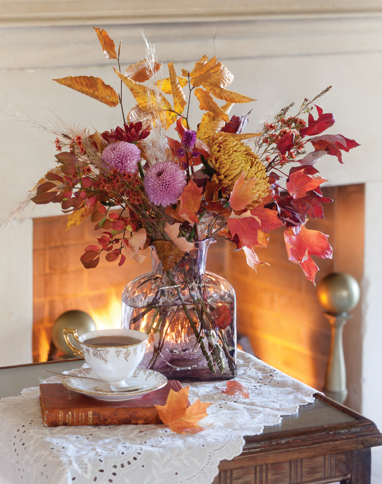 Arrangement - Colorful pumpkins, vegetables, and flowers emerge from the earth's abundance to lend their flair to the splendid pageantry and create elegant arrangements.