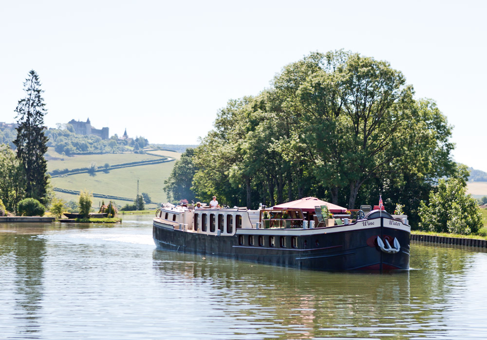 Passengers travel in comfort aboard the hotel barge Wine & Water in Burgundy, France
