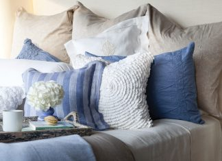 A bed piled high with lofty pillows and layered in luxury often paves the way to a journey into dreamland.