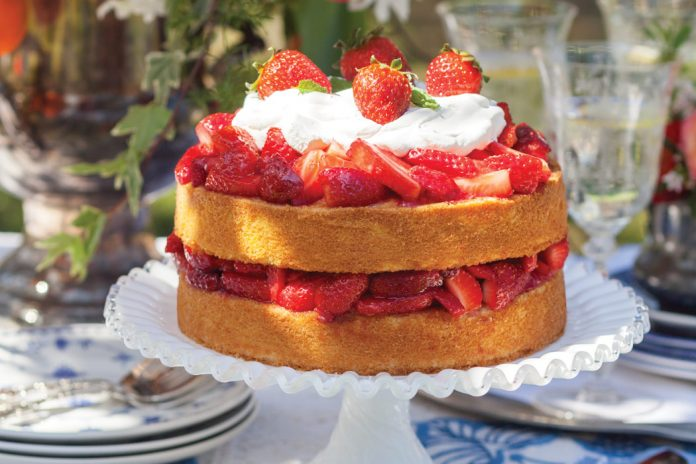 Tiers of delicate sponge cake covered in succulent berries and a cloud of whipped cream with a hint of Grand Marnier make Strawberry Shortcake a perennial favorite of every generation.
