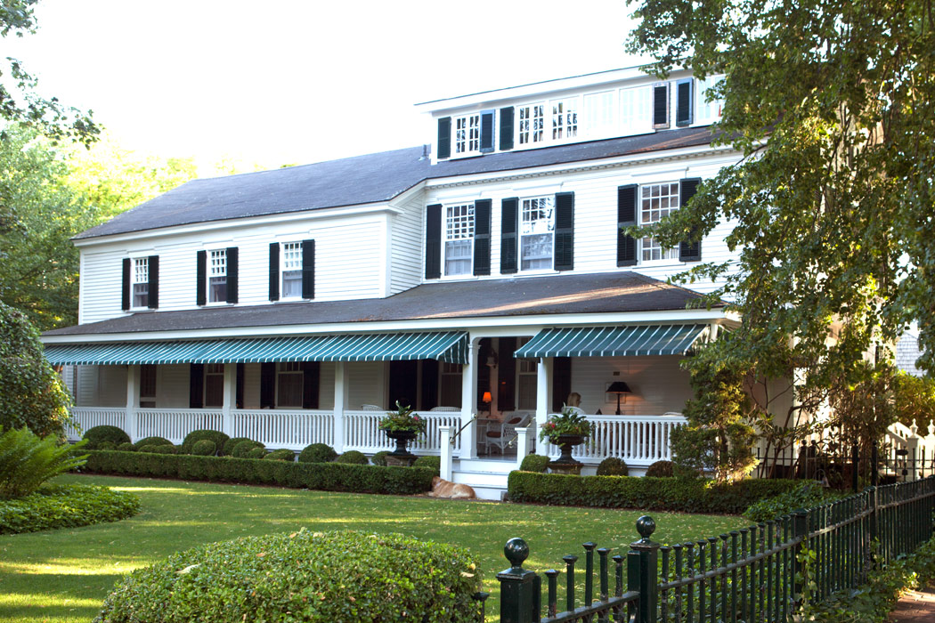 The Charlotte Inn, a historic property, serenely awaits visitors with its updated brilliant white paint and carefully tended lawns.