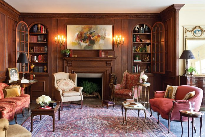 Old-World tradition meets contemporary comfort in the home of Susan and Don Huff, where the patina of aged-oak paneling in the living room serves as a fitting backdrop for character-infused antiques.